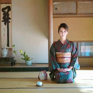 Japan, Kyoto, Enko Temple, woman in kimono kneeling in temple, portrait